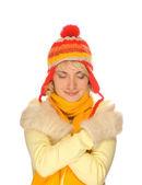 Congelados chica en ropa de invierno colorido sobre fondo blanco — Foto de Stock