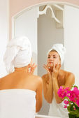 Beautiful girl massages her face — Stock Photo
