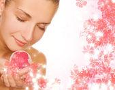 Beautiful girl with aroma bath ball — Stock Photo