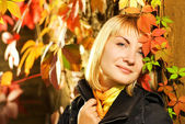 Sexy blond girl on autumn background — Stock Photo
