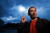 Funny guy over dark cloudy sky before rain — Stock Photo