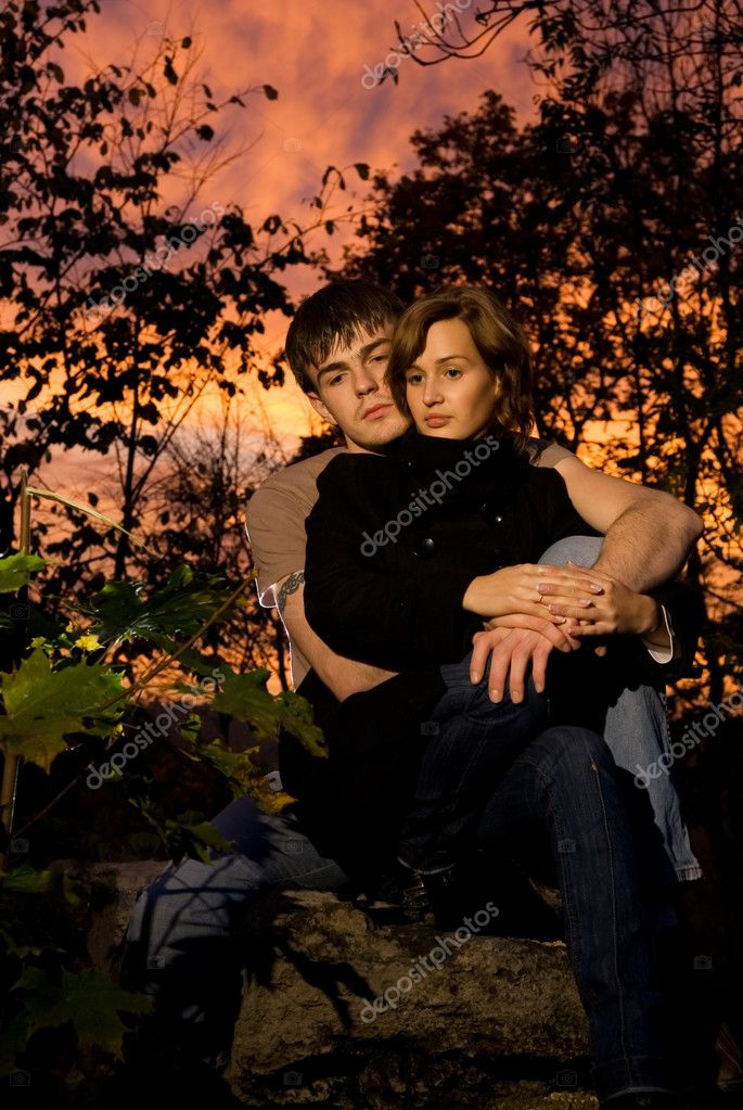Young couple in love at sunset time — Stock Photo #4959362