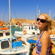 Beautiful blond girl in sunglasses near the yacht club — Stock Photo