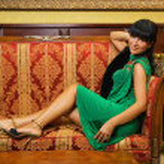Beautiful brunette on a luxury sofa — Stock Photo