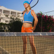 Stock Photo: Attractive young female tennis player