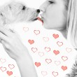 Blond girl with a sweet puppy on abstract heart background — Stock Photo #4960157