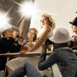 Beautiful blond girl looking like a superstar posing and lots of — Stock Photo