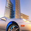 Modern sport car in front of office building — Stock Photo #4960362