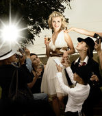 Beautiful blond girl and lots of fans around her — Stock Photo