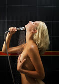 Beautiful blond girl takes shower — Stock Photo