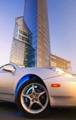 Modern sport car in front of office building — Stock Photo
