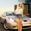 Sexy blond girl sits on modern sport car — Stock Photo