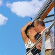 Middle-aged couple kissing on a balcony - Stockfoto