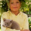 Little girl with a kitten - Stock Photo