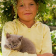 Stock Photo: Little girl with kitten
