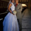 Bride and groom near the river at sunset time — Stock Photo