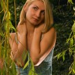Beautiful blond girl alone in the forest — Stock Photo #5098041