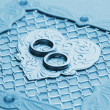 Luxury handmade wedding card element (toned in blue) - Stock Photo