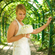Stock Photo: Beautiful redhead girl with bridal bouquet of white roses