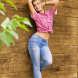 Sexy blond girl near the wooden wall — Stock Photo