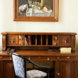 Luxury cabinet with a painting on the wall - Stok fotoğraf