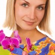 Blond girl with purple orchid — Stock Photo #5098441