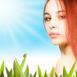 Beautiful girl on a lawn — Stock Photo #5098478