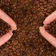 Two handfulls of coffee — Stock Photo #5098482