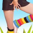 Girl's legs in colorful gaiters — Stock Photo