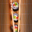 Sushi and wooden chopsticks — Stock Photo