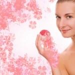 Beautiful girl with aroma bath ball — Stock Photo #5098558