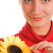 Beautiful girl with a sunflower — Stock Photo #5098591