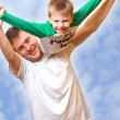 Royalty-Free Stock Photo: Father playing with son