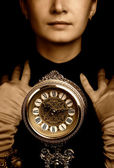Sepia portrait of a girl with a clock — Stok fotoğraf