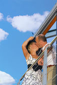 Middle-aged couple kissing on a balcony — Stock Photo