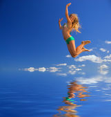 Little girl jumps over water — Stock Photo