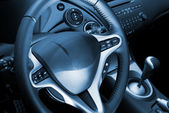 Car interior toned in blue — Stockfoto