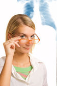 Beautiful joung doctor in a laboratory — Stock Photo