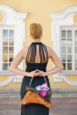 Redhead girl with a floral handbag — Stock Photo