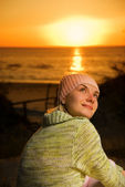 Beautiful girl on the beach at sunset time — Stock Photo