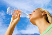 Beautiful girl drinking water — Stock Photo