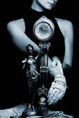 Girl whith a clock (toned in blue) — Stock Photo