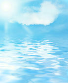 Sunny sky and blue water background — Stock Photo