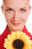 Attractive young girl with a sunflower — Stock Photo