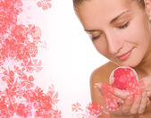 Beautiful girl with a aroma bath ball — Stock Photo