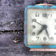 Stock Photo: Old alarm on wooden board
