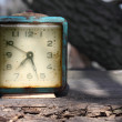 Stock Photo: Retro alarm on wooden board