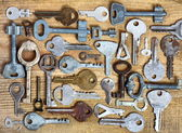 Old keys on wooden background — Stock Photo