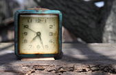 Retro alarm on wooden board — Stock Photo