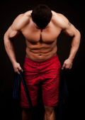 Athlete exercising with rope — Stock Photo
